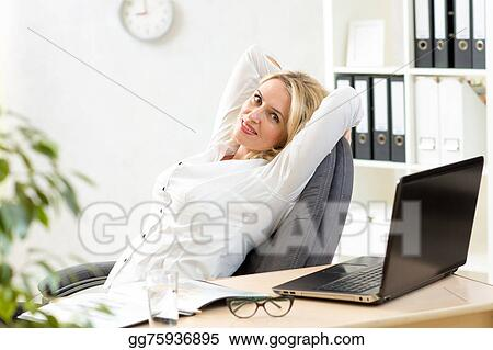 Stock Photos - Senior business woman relaxing at work in office