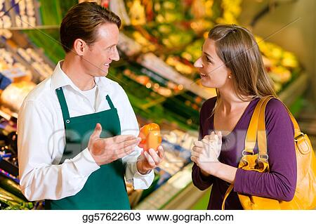Pictures - Woman in supermarket and shop assistant Stock Photo