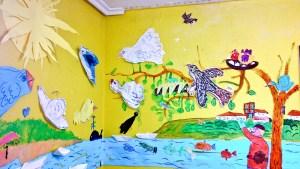 Mural conjunto de varios niños y edades