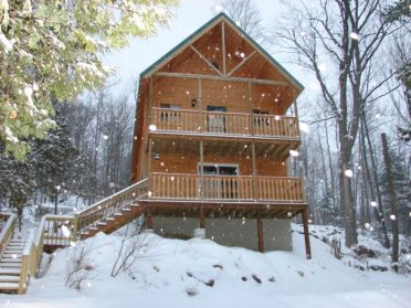 A frame log home in the snow