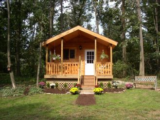 small log cabin with flowers