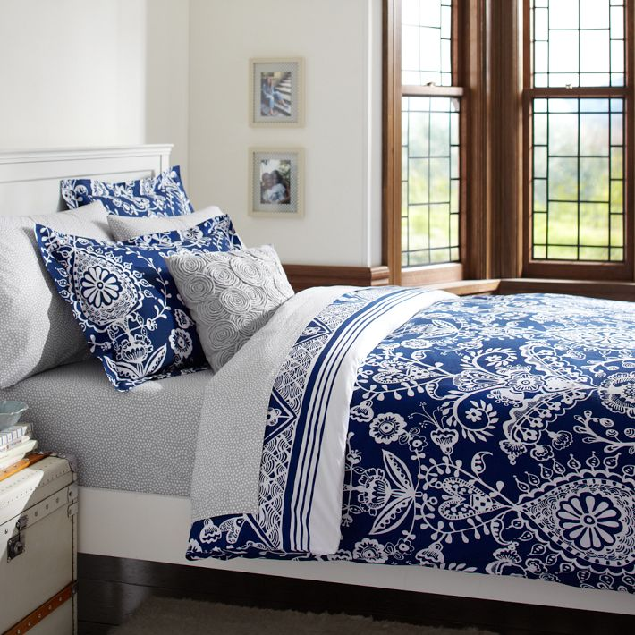 Love the look of a bed that has been dressed in layers which