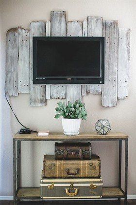 TV mounted on wood planks