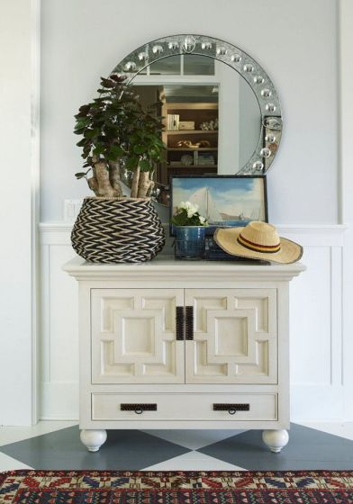 Round Mirror in Hallway via Homebunch