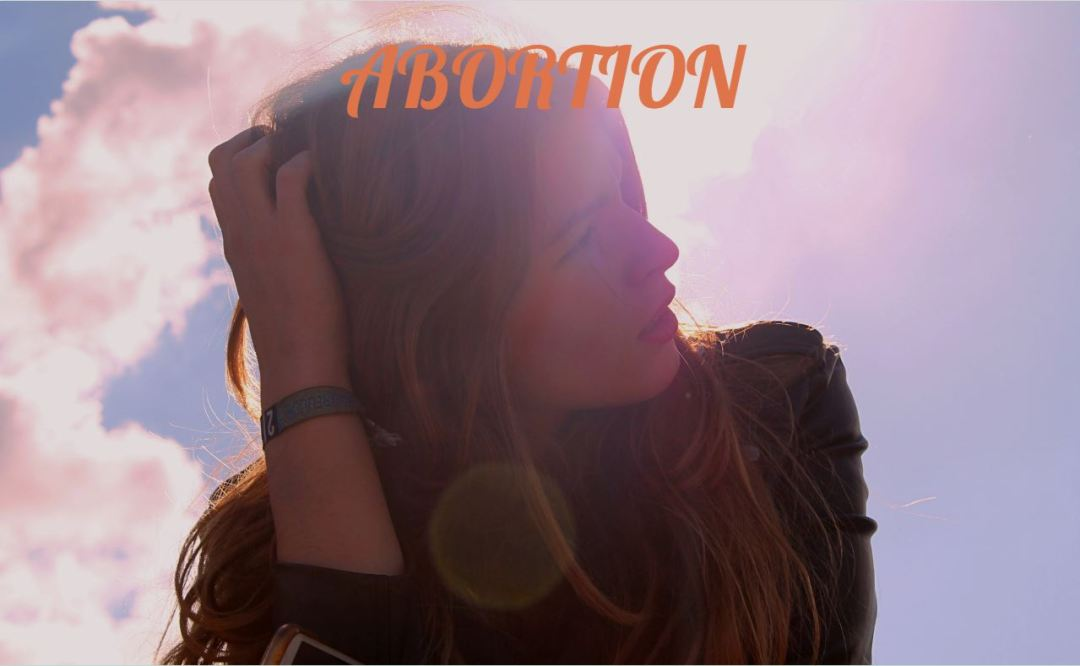 girl looking at sky with Abortion text