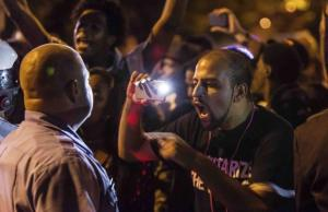 A demonstrator confronts a St. Louis Metropolitan Police officer in St. Louis