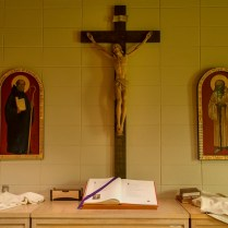 Inside the sacristy, with St. Benedict and St. Romuald flanking the crucifix.