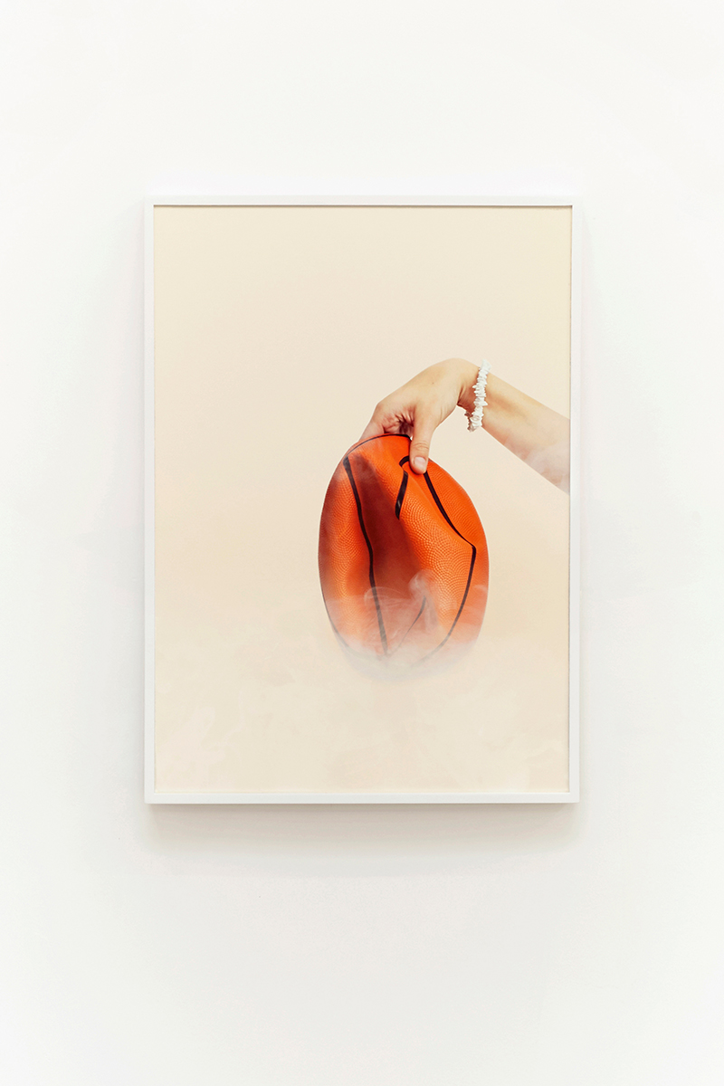 Juliana Paciulli, Uh-Huh (Basketball) (2015). Archival pigment print in artist's frame, 16 x 22.5 inches. Image courtesy of the artist and Greene Exhibitions.