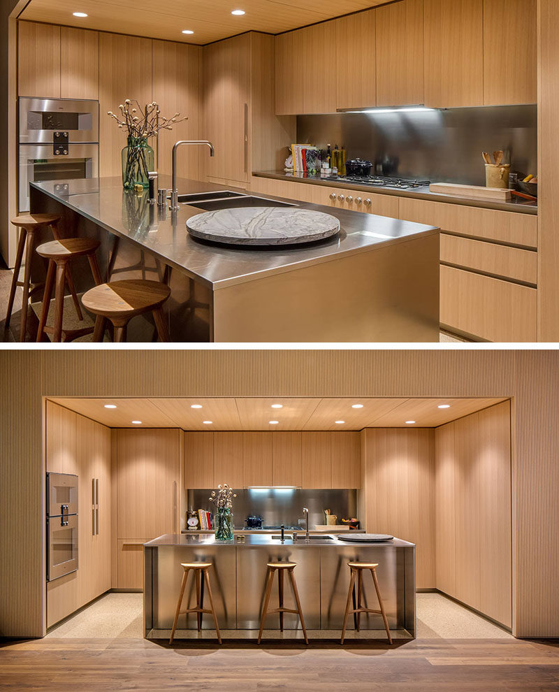 Stainless Countertop Oak Cabinets And Satin Finish Stainless Steel Make Up This Modern