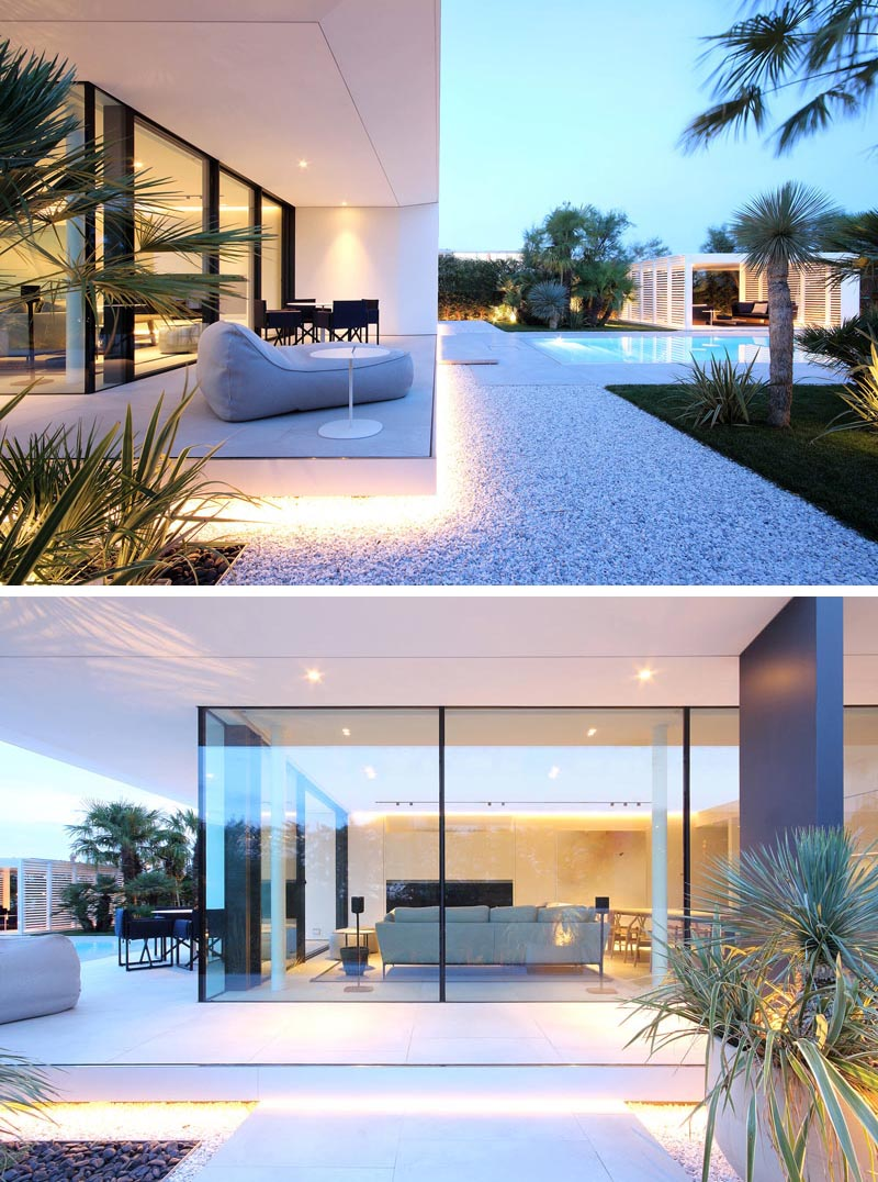 Outdoor Lighting Adds A Dramatic Element To This Modern White House