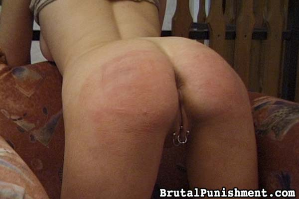 caning her asshole