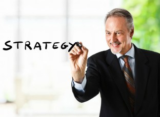 businessman writing strategy
