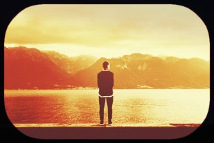 guy viewing water, mountains-scenic