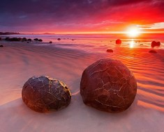 Moeraki Boulders during a stunning sunrise in New Zealand