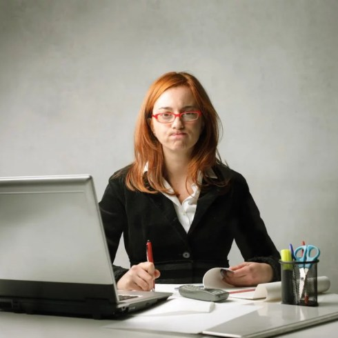 Boring work | Bored businesswoman working at her desk