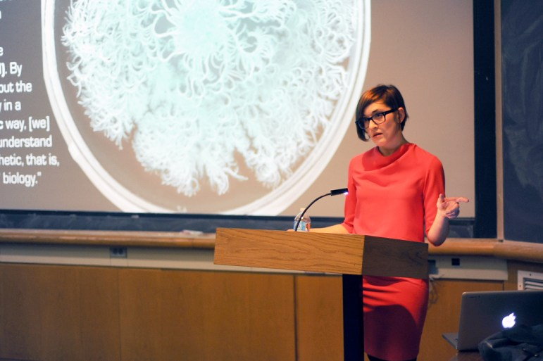 Prof. Sophia Roosth, history of science, Harvard University, speaks about the way we understand and define life in Kaufmmann Auditorium Thursday. (Brittney Chew / Sun News Photography Editor)