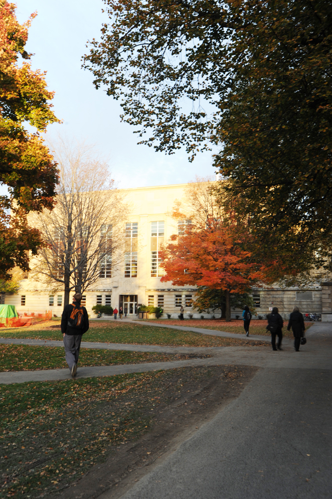 A student walks toward Mann Library on the Ag Quad, a part of the College of Agriculture and Life Sciences.