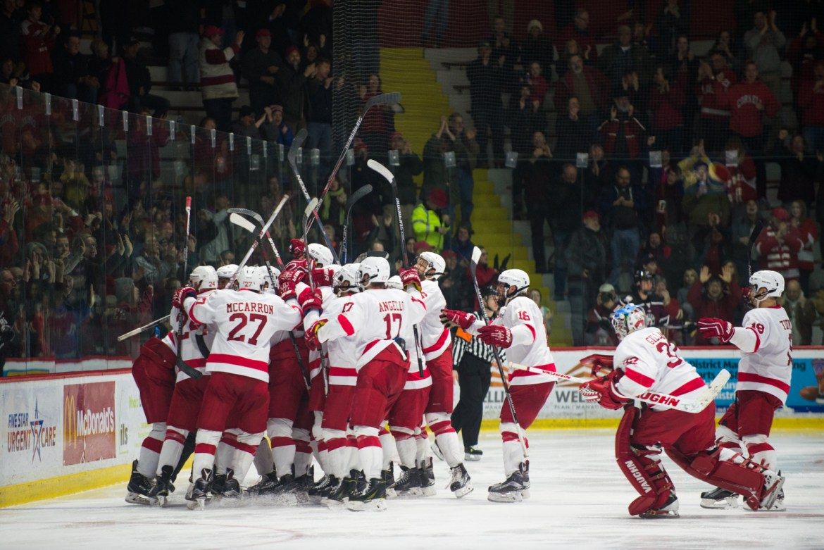 The men of the hockey team celebrate as they advance past Union in the ECAC Playoffs.