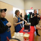 Members of the Cornell community hand out and eat the ice cream  flavor that President Elizabeth Garrett helped design.