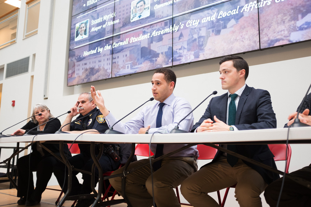Svante Myrick '09 discusses the benefits of The Ithaca Plan at a town hall Tuesday.