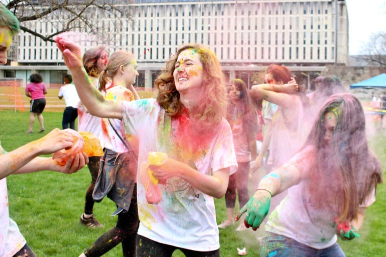 Students throw colored powder at each other on the Arts Quad Saturday in celebration of Holi, the Hindu spring festival.