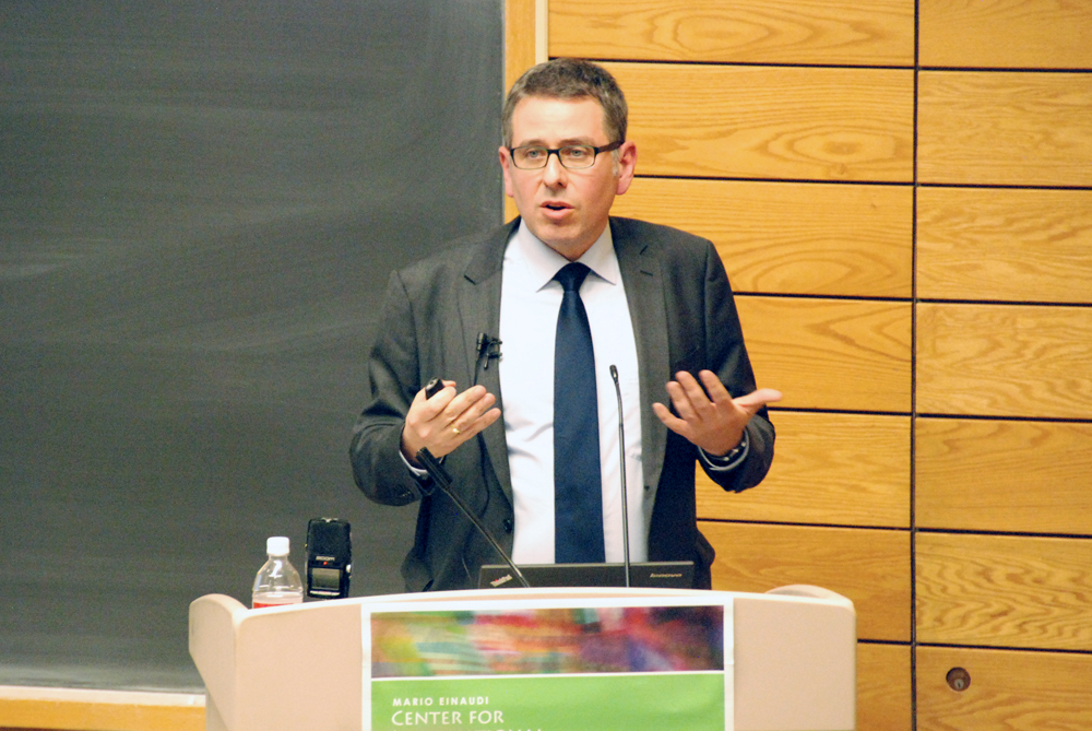 Andreas Wüst, a German immigration official, discusses the refugee crisis in Germany in Goldwin Smith Hall on Monday.