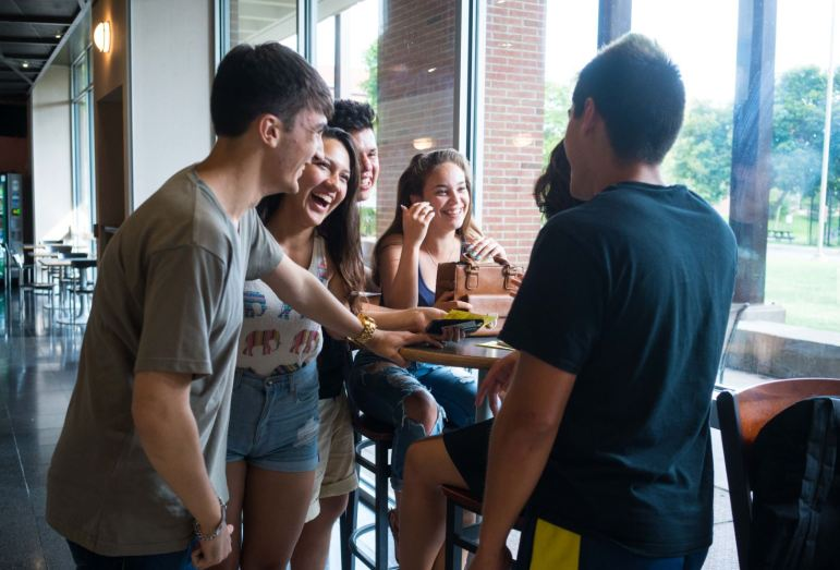 Freshmen talk about their first day of classes at Bear Necessities on Tuesday.