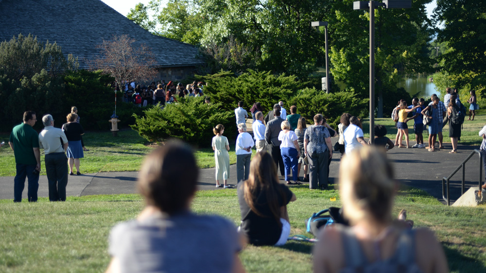 Students gather at Muller Chapel at Ithaca College on Aug. 29, 2016 to remember Anthony Nazaire, who was stabbed on Cornell's campus the day before.