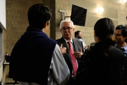 Robledo speaks to students after a lecture in Ives Hall Thursday.