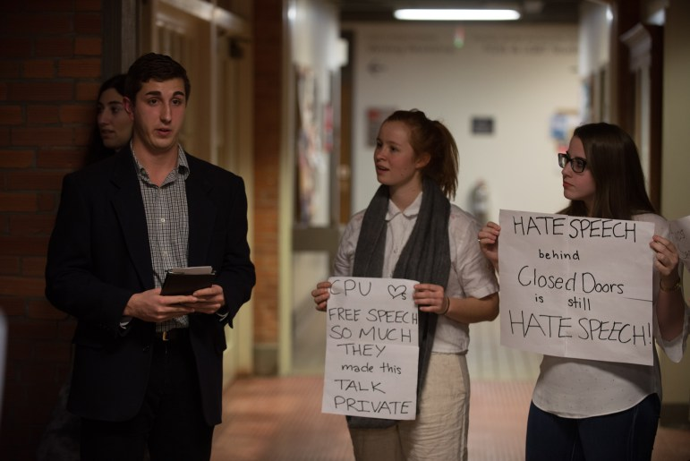 Protesters at Michael Johns' speech in Rockefeller Hall on Tuesday evening.