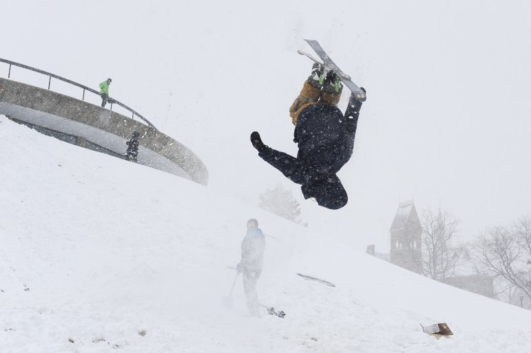 Wyatt Buchalter '18 completes a flip as he skis down Libe Slope during Winter Storm Stella on Tuesday.