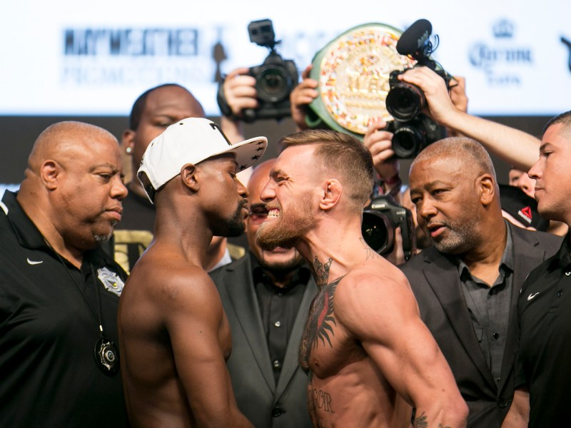 Floyd Mayweather Jr. left, and Conor McGregor face off after their weigh-ins at T-Mobile Arena in Las Vegas, Aug. 25, 2017. In a city of illusion and circuses, Mayweather and McGregor pulled off a boxing spectacle in Las Vegas fit for the times.