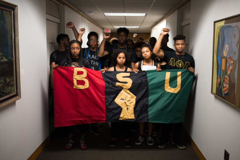 Black Students United, led by co-chairs Traciann Celestin '19 and Delmar Fears '19, center, march through Day Hall prior to delivering a list of demands to Cornell President Martha Pollack and occupying Willard Straight Hall on Wednesday, Sept. 20, 2017.
