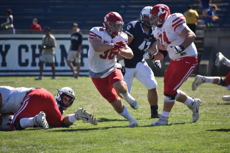 Senior running back Jack Gellatly going for rush attempt against Yale Saturday. Cornell managed just 24 yards on the ground not including a 90-yard touchdown run.