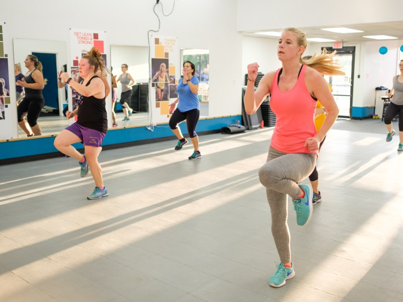 Fitness club members participate in a bodycombat class at FLX Fitclub.