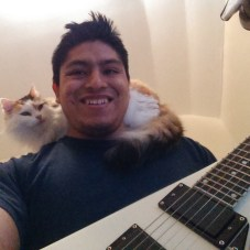 José Guzman-Lopez, 32, pictured here with his cat and guitar.