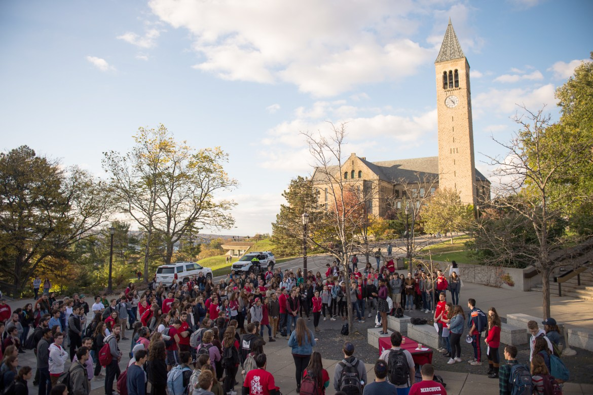 Hundreds of students gathered on Ho Plaza wearing red to protest anti-Semitic flyers found on campus Monday morning.