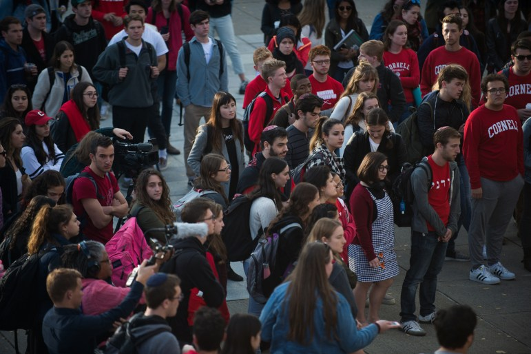 Students protest anti-Semitism and white supremacy after posters marked with swastikas were found on campus Monday morning.