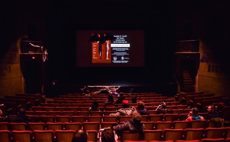 """Visitors settle at Cornell Cinema before the screening of """"Night of the Living Dead"""" on Halloween 2017."""