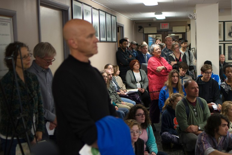 People crowd Ithaca City Hall at the Common Council meeting on Wednesday, Nov. 1, to hear the final verdict on the Chacona Block's historical designation.