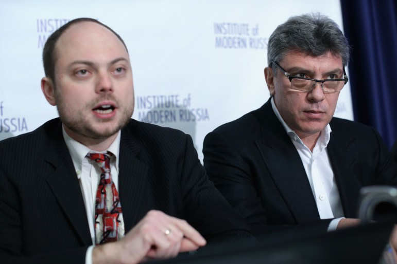 "WASHINGTON, DC - JANUARY 30:  Vladimir Kara-Murza (L), speaks as Russian opposition leader and former Deputy Prime Minister Boris Nemtsov (R) listens during a news conference on ""Corruption and Abuse in Sochi Olympics"" January 30, 2014 at the National Press Club in Washington, DC.  (Photo by Alex Wong/Getty Images)"