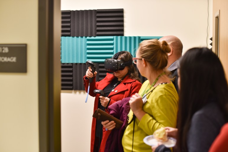 A visitor experiences virtual reality at the grand opening of MannUfactory on Thursday.