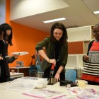 Community members participate in Galentine's Day activities at MannUfactory.