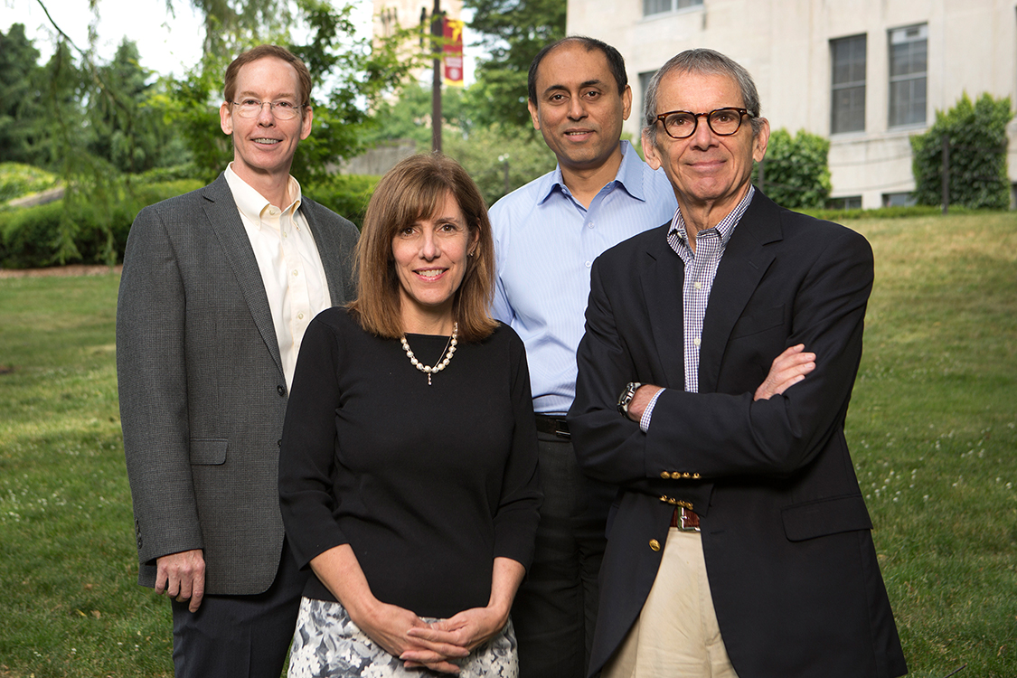 From left to right, in this 2016 photo: Mark Nelson, dean of the Johnson Graduate School; Kate Walsh, dean of the School of Hotel Administration; Soumitra Dutta, former dean of the College of Business; and Ed McLaughlin, former interim dean of the Dyson School.