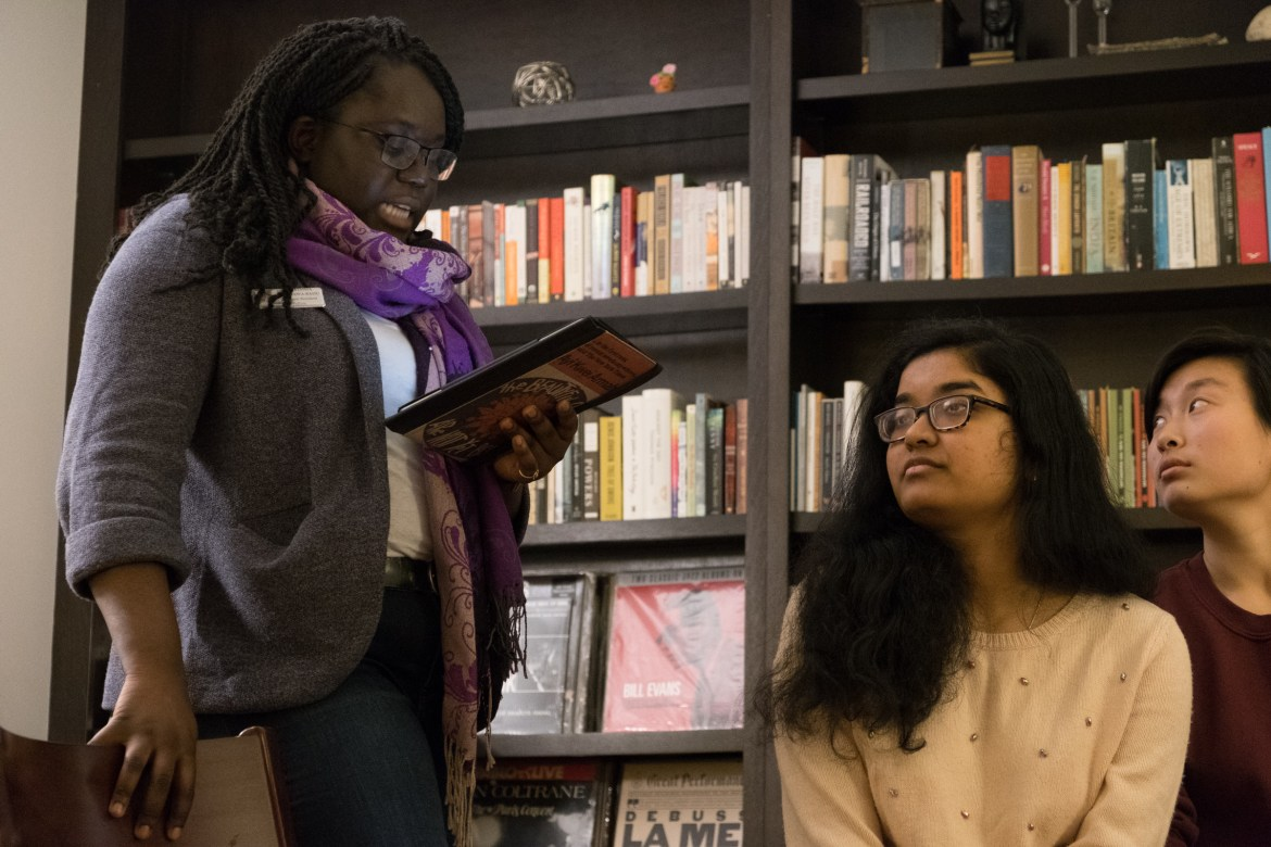 "Students and community members discuss Toni Morrison's M.A. '55 ""The Origin of Others"" at a read-in at Keeton House on Wednesday night."