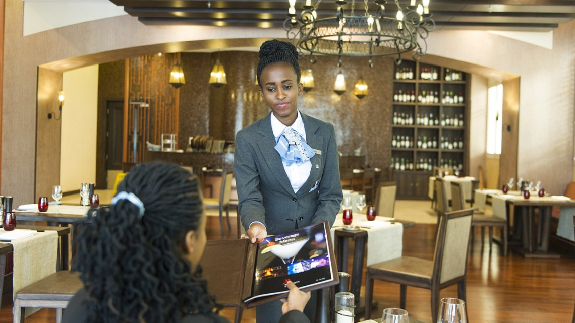 A participant of the Mastercard Foundation's initiative gains hospitality experience.