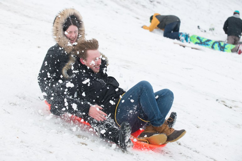 Students flocked to Libe Slope with cardboard boxes and sleds after classes were cancelled. (Cameron Pollack/Sun Senior Photographer)