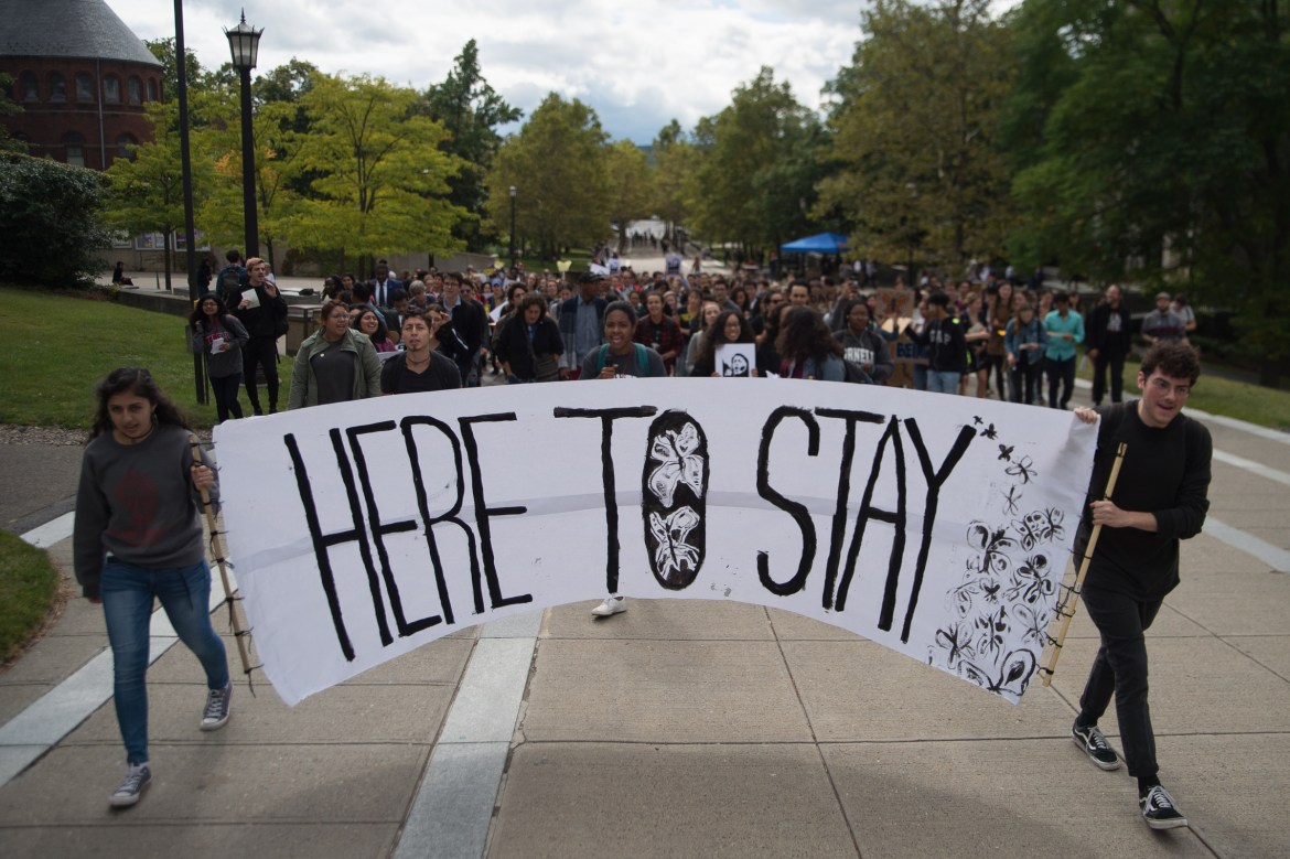 Students and community members march up Ho Plaza at the Cornell DREAM Team's protest against the recision of the Deferred Action for Childhood Arrivals program on September 8th, 2017.