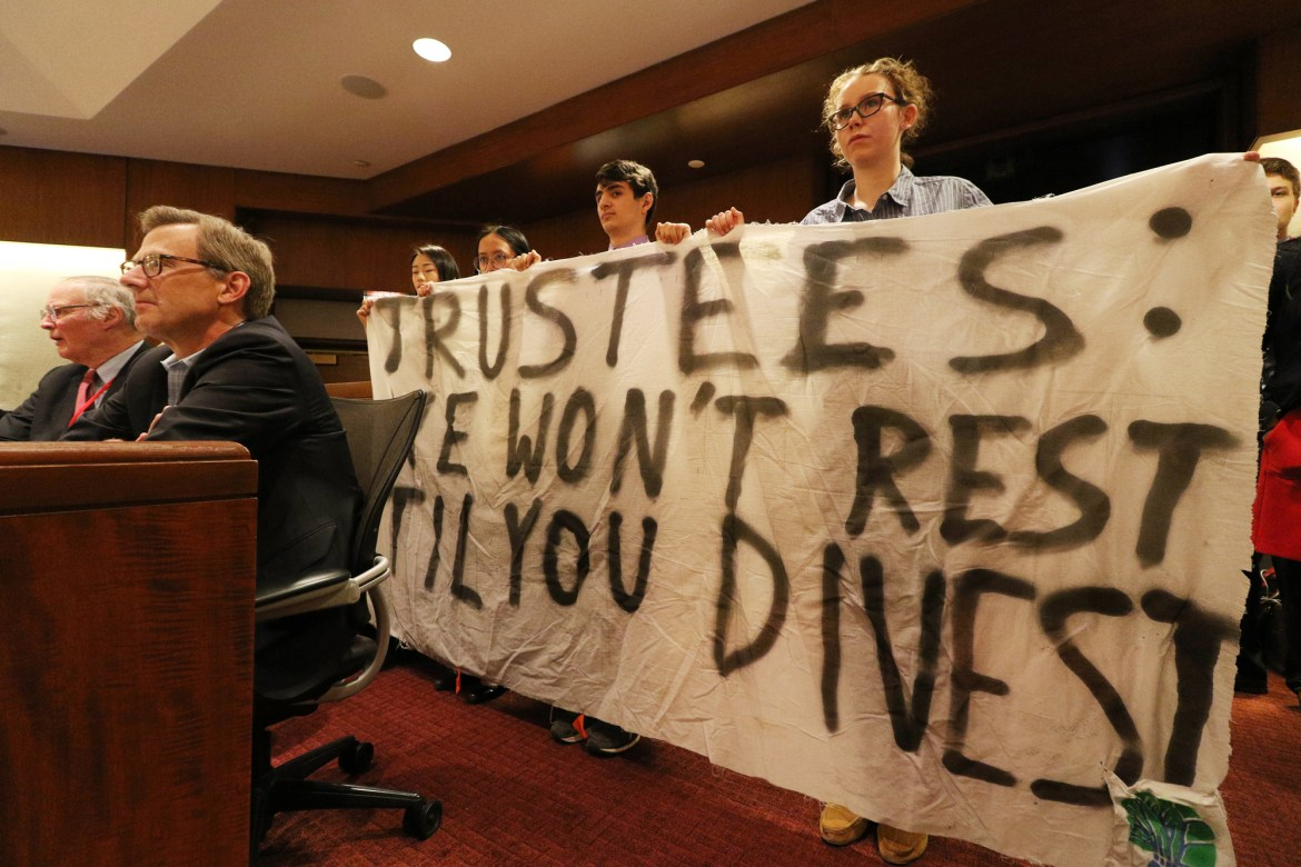 Students protest at a Board of Trustees meeting on March 23.