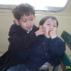 Jason '19 and Eric '22 Jeong on the ferry to Ellis Island in 2002.